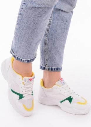Белые кроссовки с желтыми вставками5 фото