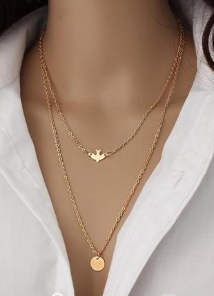 Двойная многослойная золотистая цепь цепочка с птицей и монетой.