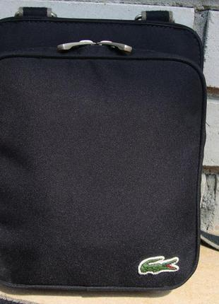 Фірмова багатофункціональна сумка кросбоді,сумка -гаманець lacoste. оригінал!!!!1 фото