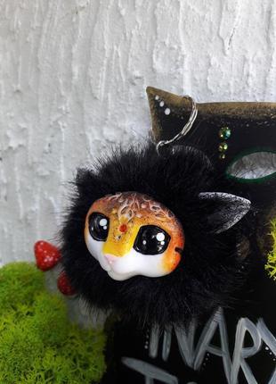 Меховый брелок на сумку/рюкзак с волшебным зверьком2 фото