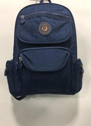 Тканевой синий рюкзак