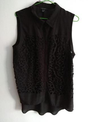Прозрачная блузка.  перед короткий сзади длиннее) размера l) свободного покрою не облегает