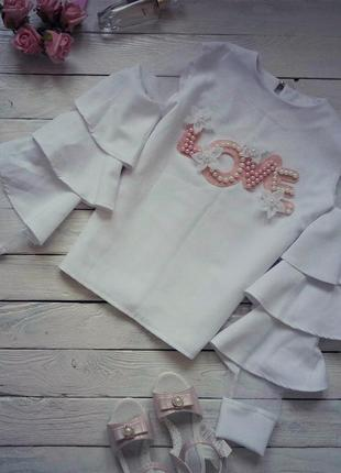 Нарядная белая блузка с рукавом волан
