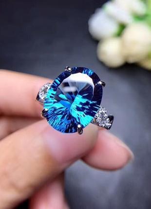 """Невероятной красоты серебряное кольцо с голубым топазом """"сердце океана"""""""