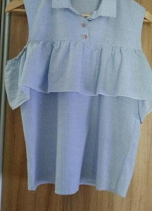 Блузка в ідеальному стані,в полоску