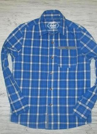 Яркая синяя в клетку котоновая рубашка фирмы ребел на 8-9 лет