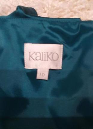 Элегантное  платье с драпировкой, на подкладке изумруд бренд kaliko 10/12р5 фото