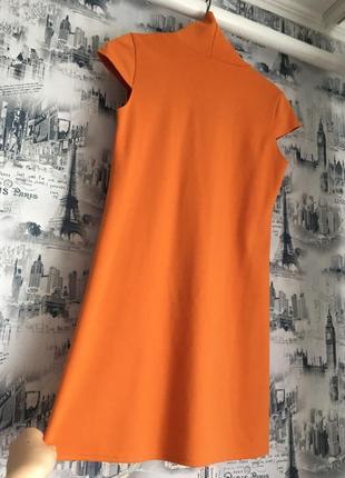 Оранжевое платье-туника с цветочным принтом