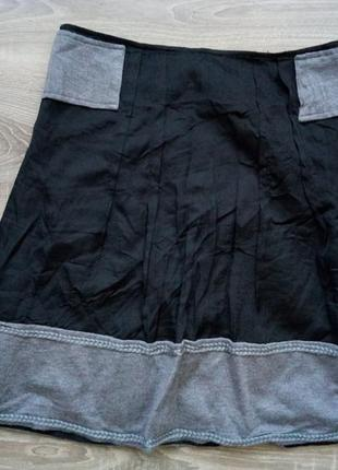 Расклешенная юбка с вязаными вставками