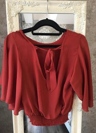 Блузка с широким рукавом