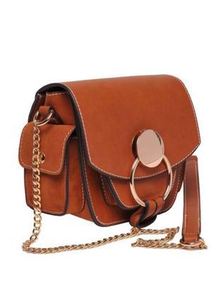 Рыжая сумочка оригинальной формы