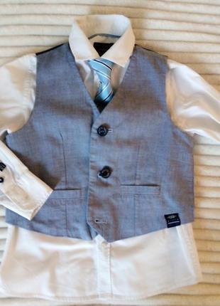 Стильна жилетка і сорочка з галстуком в тон