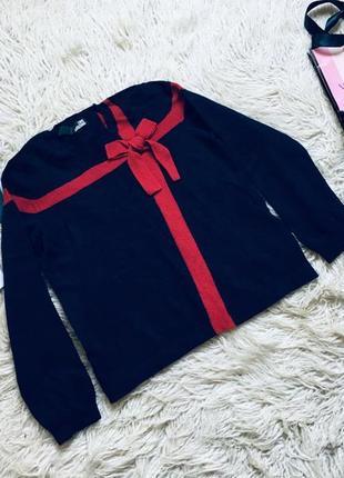 Шерстяной оригинальный свитер с бантом