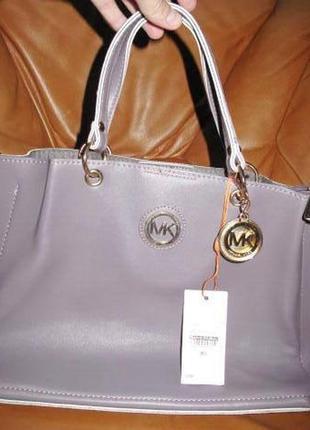 Елегантна фіолетова сумка нова бірки еко шкіра