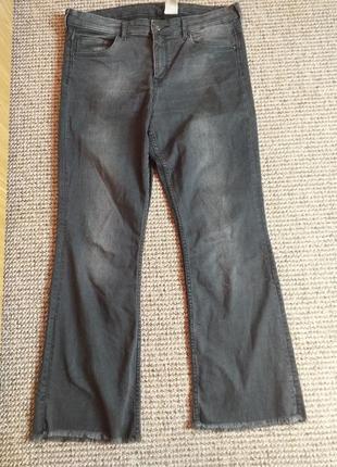 Укороченные джинсы с бахромушкой внизу раз.32 наш 16/18
