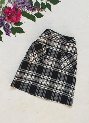 Стильная юбка в чёрно белую  клетку с карманами сзади на молнии от laura torelli