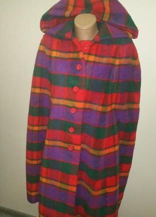 Стильно пальто -шинель  плечи приблизительно 54-55 длина по спинке 100 см ширина в зоне прорезей для