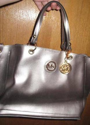 Елегантна бронзова  сумка нова бірки еко шкіра
