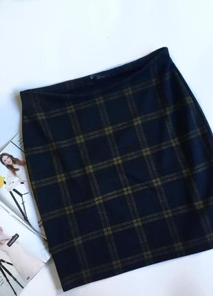 Стильная черная юбка new look в клетку, отлично будет сочетаться с разнообразным верхом.