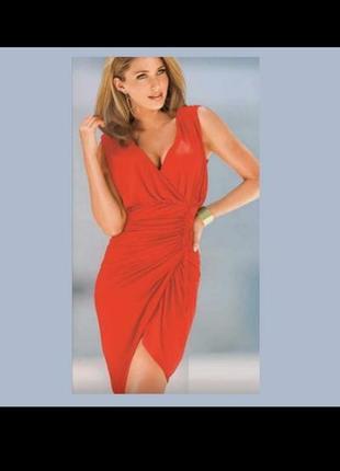 Обалденное качественое коктельное оранжевое платье на запах ассиметричное