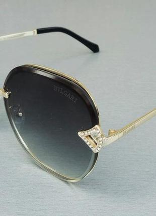 Bvlgari очки женские солнцезащитные в металлической оправе с камнямм