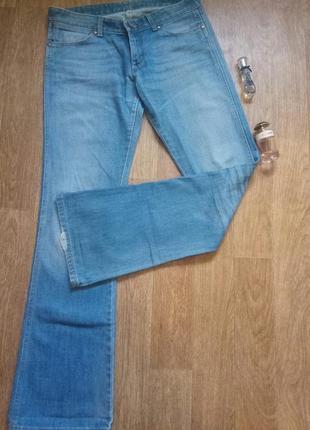 Модные джинсы клеш низкая посадка