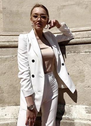 Белый двубортный жакет украинского бренда the lace