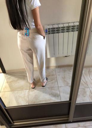 Бежевые брюки4 фото