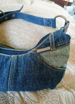 Очень компактная джинсовая сумка от известного бренда ted baker