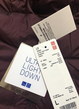 Легкая куртка на пуху uniqlo, складывается в мешочек, на бирочке размер l3 фото