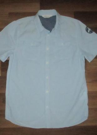 Голубенькая котоновая рубашечка фирмы h&m на 13-14 лет