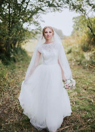 Нежное воздушное свадебное платье белого цвета7 фото