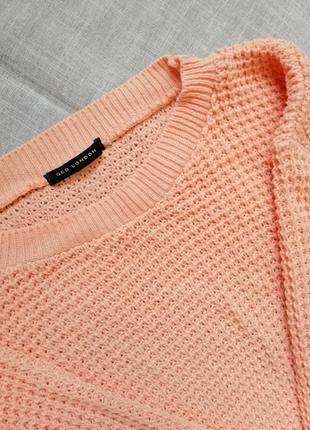 Вязаная укороченая кофточка персикового цвета