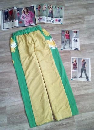 Зеленые с желтой вставкой - сеткой спортивные брюки с карманами l. red chic