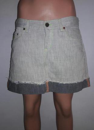 Джинсовая юбка  с отворотом по низу и салатовой строчкой