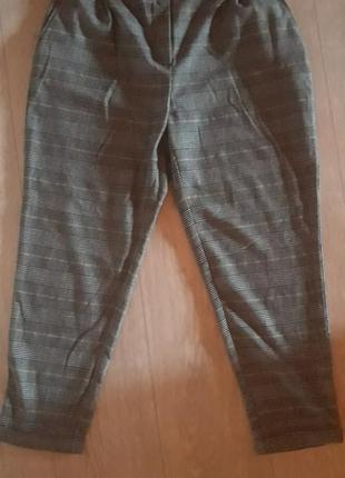 Шерстяные укороченные свободные брюки в клетку