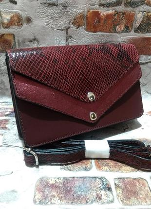 Женская сумочка-клатч из натуральной кожи.