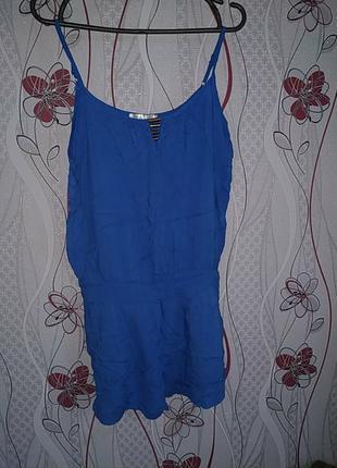 Синий комбинезон с карманами